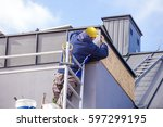 roofer assembles sheet metal on ... | Shutterstock . vector #597299195