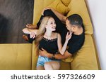 loving couple embracing  lying... | Shutterstock . vector #597326609