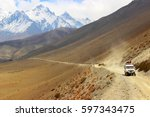 a car with tourists on a... | Shutterstock . vector #597343475