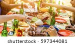 happy friends eating barbecue... | Shutterstock . vector #597344081