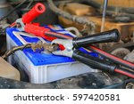 jumper cable  car battery with... | Shutterstock . vector #597420581