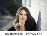 beautiful young brunette woman... | Shutterstock . vector #597421679
