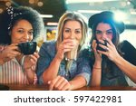 three young women front... | Shutterstock . vector #597422981