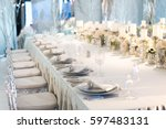 banquet table decor. candles in ... | Shutterstock . vector #597483131