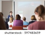 female speaker giving... | Shutterstock . vector #597483659