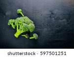 fresh broccoli on dark wooden... | Shutterstock . vector #597501251