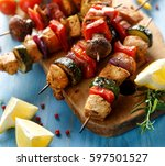 grilled skewers with vegetables ... | Shutterstock . vector #597501527