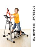 Smiling boy playing on elliptical trainer in the gym - isolated - stock photo