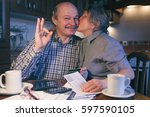 a married couple counts money... | Shutterstock . vector #597590105