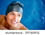 Professional male swimmer wearing a hat and goggles - stock photo