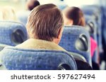 transport, tourism, road trip and people concept - close up of senior man sitting in travel bus - stock photo