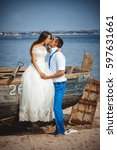 wedding couple in a boat on the ... | Shutterstock . vector #597631661