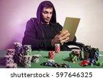 poker player playing online via ... | Shutterstock . vector #597646325