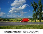 red delivery truck on asphalt... | Shutterstock . vector #597649094