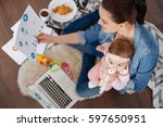 inspiring modern mother... | Shutterstock . vector #597650951