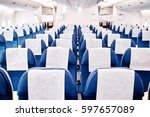 empty airplane seats in the... | Shutterstock . vector #597657089