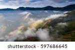 beautiful landscape with fog... | Shutterstock . vector #597686645