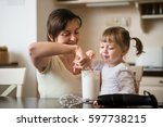 mother and her child licking... | Shutterstock . vector #597738215