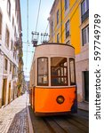 Small photo of Lisbon Portugal, Vintage Yellow Tram in Bairo Alto District
