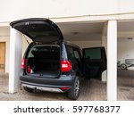 car parking with open trunk. | Shutterstock . vector #597768377
