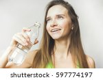 happy woman with water | Shutterstock . vector #597774197