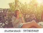 cute girl having morning coffee ... | Shutterstock . vector #597805469