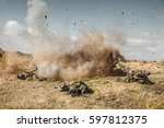 Small photo of Squad of elite french paratroopers of 1st Marine Infantry Parachute Regiment RPIMA ambushed in action, landmine exploding, they are killed