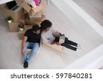 african american couple sitting ... | Shutterstock . vector #597840281