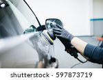 car detailing   hands with... | Shutterstock . vector #597873719