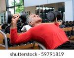 mature man lifting dumbells at... | Shutterstock . vector #59791819