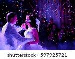 confetti fall on wedding couple ... | Shutterstock . vector #597925721