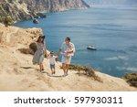 happy family of four walking in ... | Shutterstock . vector #597930311