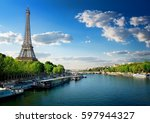 river seine and eiffel tower in ... | Shutterstock . vector #597944327