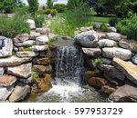 A Lush Green Garden With...