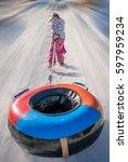 little girl pulling her... | Shutterstock . vector #597959234