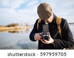 photographer with vintage photo ... | Shutterstock . vector #597959705