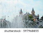 Small photo of Water fountain at Cluj-Napoca Avram Iancu Square, Transylvania region of Romania.At the background is Lucian Blaga National Theatre.