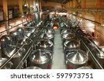 Small photo of Beer production plant, several rows of steel tanks. View from above.