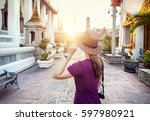 tourist woman in the hat and... | Shutterstock . vector #597980921