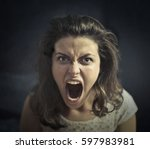 angry girl shouting  | Shutterstock . vector #597983981