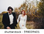 the brides walking along bank | Shutterstock . vector #598039601