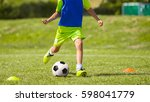 young soccer player kicking... | Shutterstock . vector #598041779