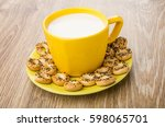 Cup Of Milk And Saucer With...