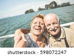 happy retired senior couple... | Shutterstock . vector #598072247