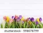 Colorful Tulips On A Wooden...