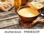 delicious cream soup with bread ... | Shutterstock . vector #598083239