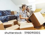 young couple moving into their... | Shutterstock . vector #598090001