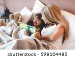 young girl reading a book with... | Shutterstock . vector #598104485