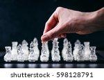 hand of man keep a figure of... | Shutterstock . vector #598128791