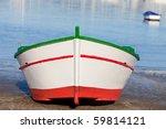 Fishing Boat On A Ramp Near Th...